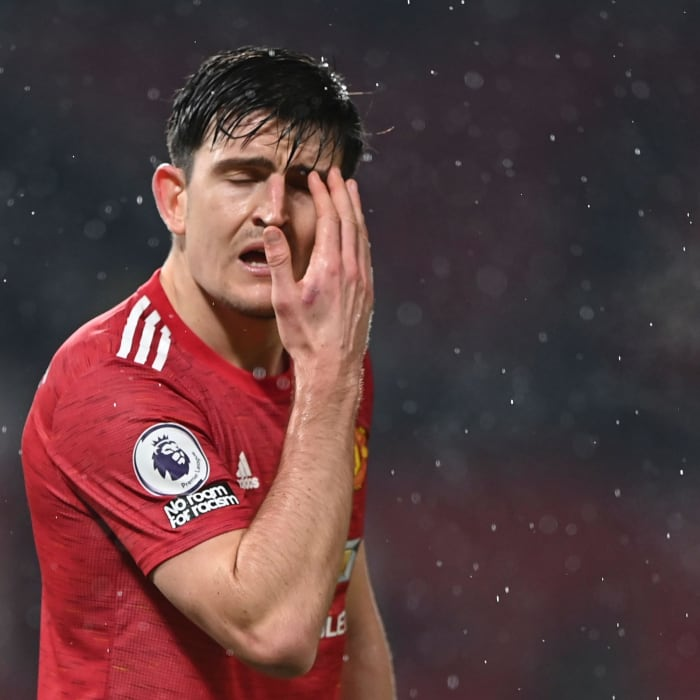 Manchester United's English defender Harry Maguire reacts during the English Premier League football match between Manchester United and Sheffield United at Old Trafford in Manchester, north west England, on January 27, 2021. (Photo by Laurence Griffiths / POOL / AFP) / RESTRICTED TO EDITORIAL USE. No use with unauthorized audio, video, data, fixture lists, club/league logos or 'live' services. Online in-match use limited to 120 images. An additional 40 images may be used in extra time. No video emulation. Social media in-match use limited to 120 images. An additional 40 images may be used in extra time. No use in betting publications, games or single club/league/player publications. /  (Photo by LAURENCE GRIFFITHS/POOL/AFP via Getty Images)