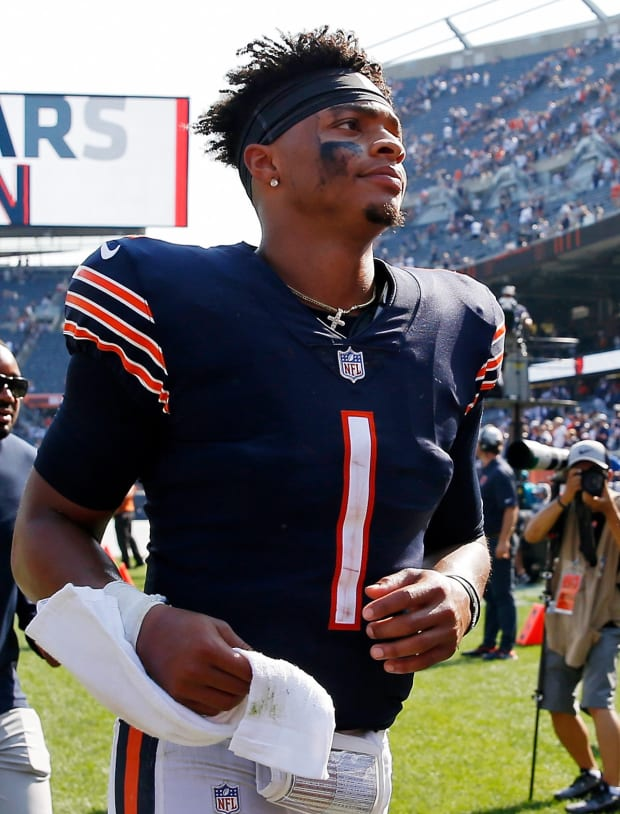 Chicago Bears quarterback Justin Fields (1) runs off the field after their 20-17 win over the Cincinnati Bengals at Soldier Field.