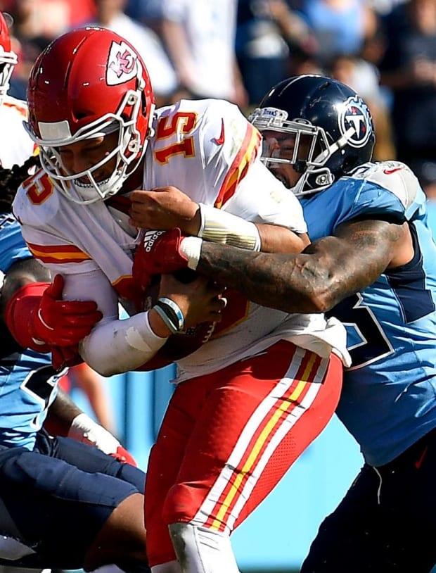 Tennessee Titans outside linebacker Harold Landry (58) sacks Kansas City Chiefs quarterback Patrick Mahomes (15) during the fourth quarter at Nissan Stadium