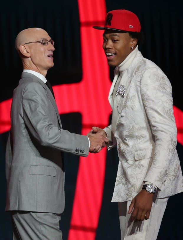 Scottie Barnes (Florida State) poses with NBA commissioner Adam Silver after being selected as the number four overall pick by the Toronto Raptors in the first round of the 2021 NBA Draft
