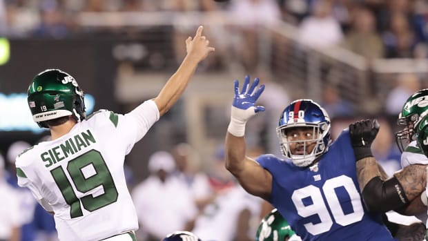 Aug 8, 2019; East Rutherford, NJ, USA; New York Jets quarterback Trevor Siemian (19) throws a pass against New York Giants defensive tackle R.J. McIntosh (90) during the first half at MetLife Stadium.
