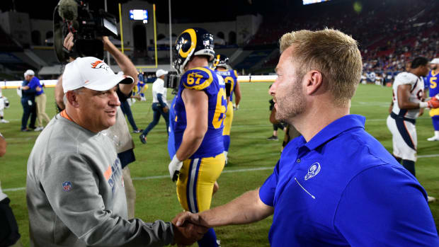 Los Angeles Rams head coach Sean McVay (right) meets with Denver Broncos head coach Vic Fangio (left) after the game at Los Angeles Memorial Coliseum.