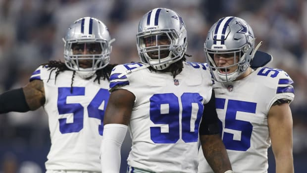 Jan 5, 2019; Arlington, TX, USA; Dallas Cowboys defensive end Demarcus Lawrence (90) and outside linebacker Leighton Vander Esch (55) react after a sack in the first quarter against the Seattle Seahawks in a NFC Wild Card playoff football game at AT&T Stadium.