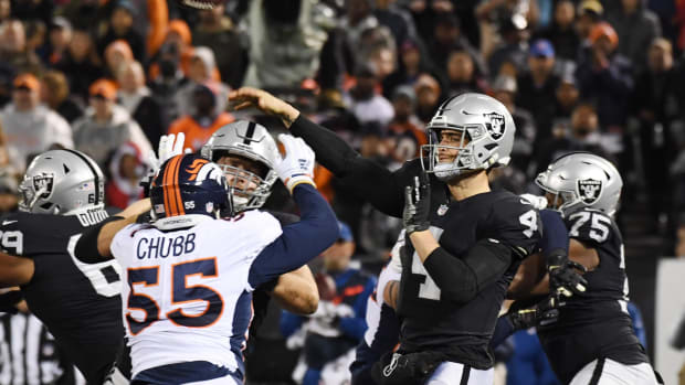 Oakland Raiders quarterback Derek Carr (4) throws a pass against the Denver Broncos in the first half at Oakland Coliseum.