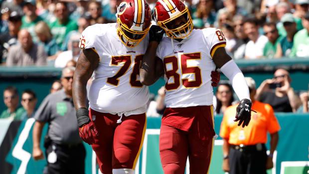 Morgan Moses, Vernon Davis (AP Photo/Matt Rourke)