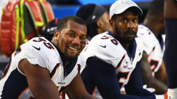 Bradley Chubb #55 of the Denver Broncos smiling on the bench with Von Miller #58 during a strong first half showing against the Arizona Cardinals at State Farm Stadium on October 18, 2018 in Glendale, Arizona.