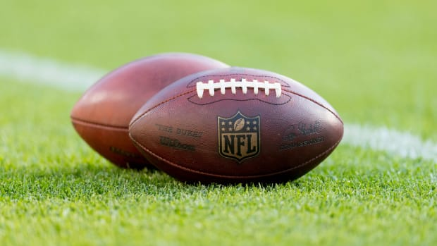 NFL footballs sit on the turf prior to the game between the Tennessee Titans and Green Bay Packers at Lambeau Field.
