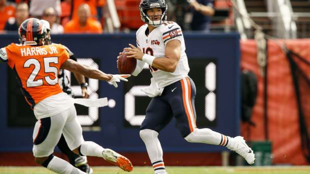 Chicago Bears quarterback Mitchell Trubisky (10) looks to pass as Denver Broncos cornerback Chris Harris Jr. (25) defends in the first quarter at Empower Field at Mile High.
