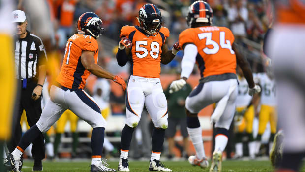 Denver Broncos outside linebacker Von Miller (58) dances following his sack of Green Bay Packers quarterback Aaron Rodgers (12) (not pictured) in the first quarter of a preseason game at Sports Authority Field.