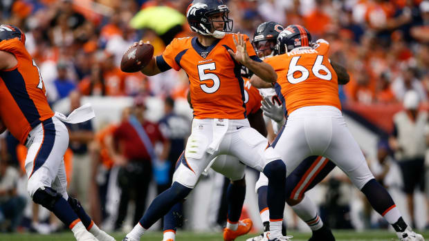 Denver Broncos quarterback Joe Flacco (5) looks to pass in the second quarter against the Chicago Bears at Empower Field at Mile High.