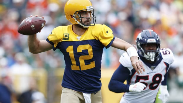 Sep 22, 2019; Green Bay, WI, USA; Green Bay Packers quarterback Aaron Rodgers (12) throws a pass under pressure from Denver Broncos linebacker Von Miller (58) during the second quarter at Lambeau Field.