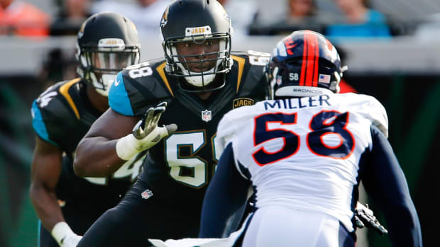 Jacksonville Jaguars tackle Kelvin Beachum (68) blocks Denver Broncos outside linebacker Von Miller (58) during the second half of an NFL football game at EverBank Field. The Broncos won 20-10.