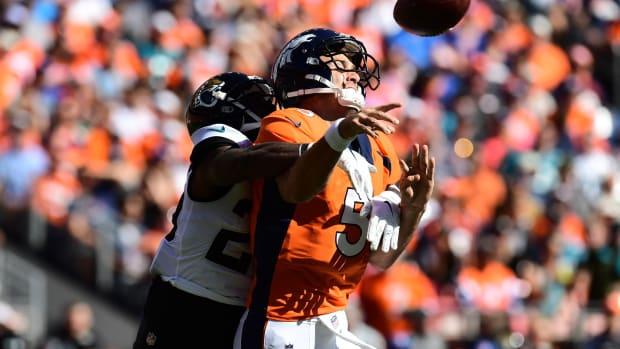 Jacksonville Jaguars defensive back D.J. Hayden (25) hits Denver Broncos quarterback Joe Flacco (5) in the first quarter at Empower Field at Mile High.