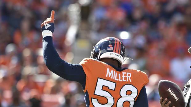Denver Broncos outside linebacker Von Miller (58) celebrates his 100th career sack at Empower Field at Mile High.
