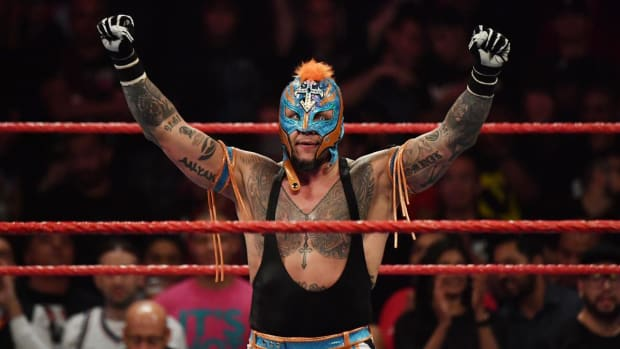 WWE's Rey Mysterio raises his hands