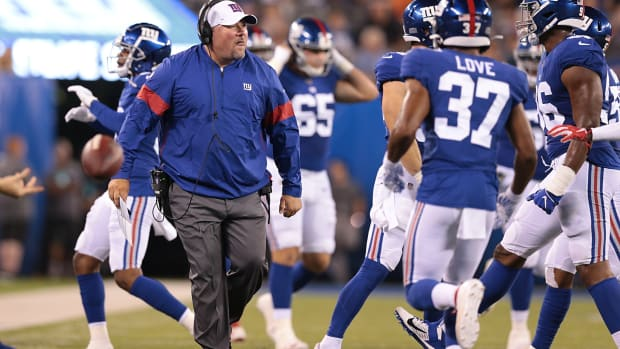 Aug 16, 2019; East Rutherford, NJ, USA; New York Giants defensive coordinator James Bettcher celebrates with players during the first half against the Chicago Bears at MetLife Stadium.
