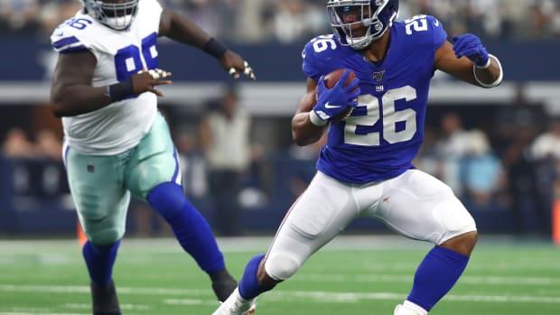 Sep 8, 2019; Arlington, TX, USA; New York Giants running back Saquon Barkley (26) runs with the ball against the Dallas Cowboys at AT&T Stadium.