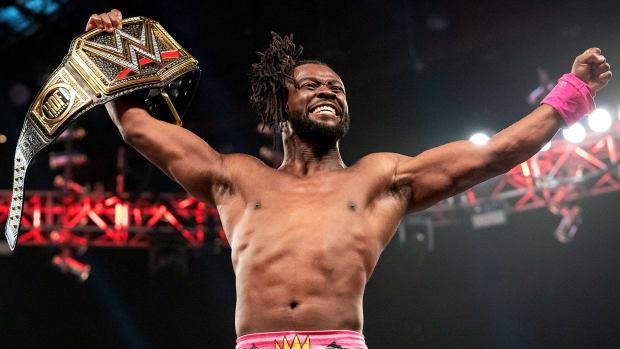 WWE Champion Kofi Kingston celebrates in the ring