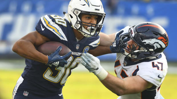 Los Angeles Chargers running back Austin Ekeler (30) tries to break free from Denver Broncos inside linebacker Josey Jewell (47) during the third quarter at StubHub Center.
