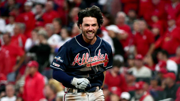 Oct 6, 2019; St. Louis, MO, USA; Atlanta Braves shortstop Dansby Swanson (7) reacts after scoring against the St. Louis Cardinals during the ninth inning in game three of the 2019 NLDS playoff baseball series at Busch Stadium. Mandatory Credit: Jeff Curry-USA TODAY Sports