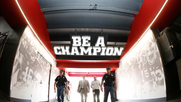 Nick Saban under the Be A Champion logo