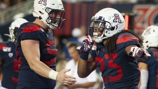 Arizona Wildcats running back Gary Brightwell (23) celebrates a touchdown against the Texas Tech Red Raiders.
