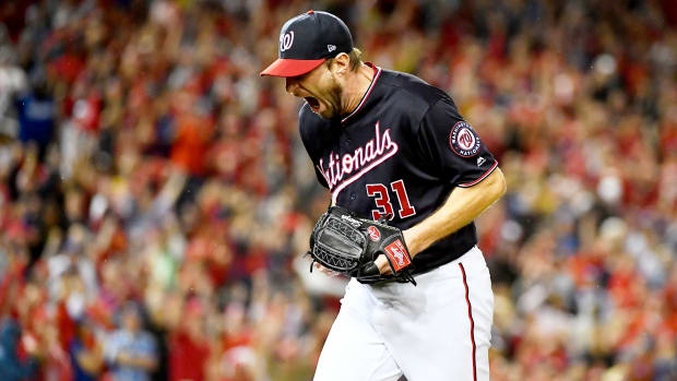 Oct 7, 2019; Washington, DC, USA; Washington Nationals starting pitcher Max Scherzer (31) reacts after the last out of the top of the seventh inning against the Los Angeles Dodgers in game four of the 2019 NLDS playoff baseball series at Nationals Park. Mandatory Credit: Brad Mills-USA TODAY Sports