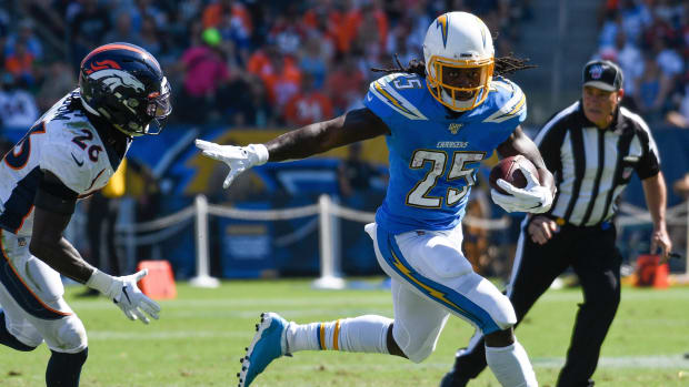 Los Angeles Chargers running back Melvin Gordon (25) tries to out run Denver Broncos cornerback Isaac Yiadom (26) during the 2nd quarter at Dignity Health Sports Park.