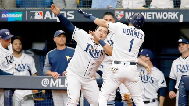 Oct 7, 2019; St. Petersburg, FL, USA; Tampa Bay Rays shortstop Willy Adames (1) celebrates his home run against the Houston Astros with first baseman Ji-Man Choi (26) during the sixth inning in game three of the 2019 ALDS playoff baseball series at Tropicana Field. Mandatory Credit: Reinhold Matay-USA TODAY Sports