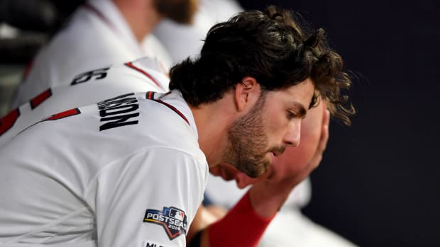 Oct 9, 2019; Atlanta, GA, USA; Atlanta Braves shortstop Dansby Swanson (7) reacts in the dugout during the sixth inning of game five of the 2019 NLDS playoff baseball series against the St. Louis Cardinals at SunTrust Park. Mandatory Credit: Dale Zanine-USA TODAY Sports