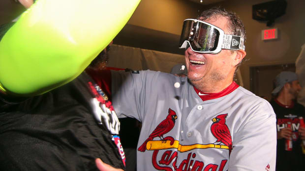 Cardinals manager Mike Shildt celebrates in the locker room.