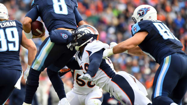 Tennessee Titans quarterback Marcus Mariota (8) is tackled by Denver Broncos linebacker Von Miller (58) during the first half at Nissan Stadium.