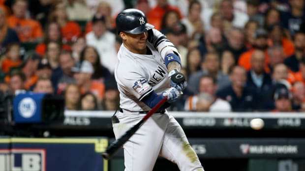 Oct 12, 2019; Houston, TX, USA; New York Yankees second baseman Gleyber Torres (25) hits an RBI double against the Houston Astros in the fourth inning in game one of the 2019 ALCS playoff baseball series at Minute Maid Park. Mandatory Credit: Troy Taormina-USA TODAY Sports