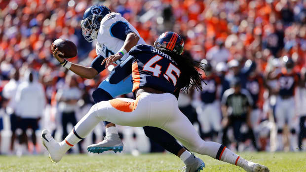 Denver Broncos linebacker Alexander Johnson (45) sacks Tennessee Titans quarterback Marcus Mariota (8) in the first quarter at Empower Field at Mile High.