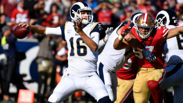 Los Angeles Rams quarterback Jared Goff (16) throws a pass under pressure from San Francisco 49ers defensive end Nick Bosa (97) during the fourth quarter at Los Angeles Memorial Coliseum.