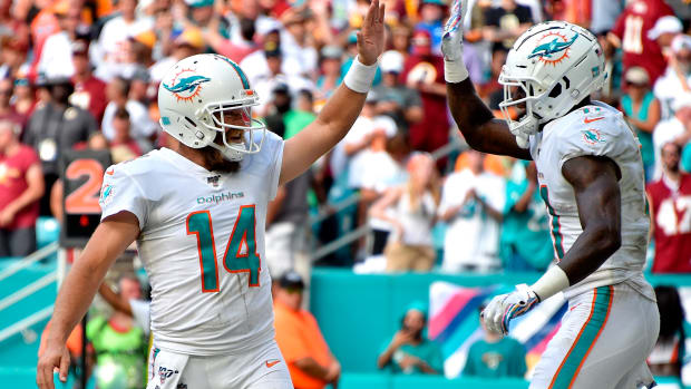 Oct 13, 2019; Miami Gardens, FL, USA; Miami Dolphins quarterback Ryan Fitzpatrick (left) greets wide receiver DeVante Parker (right) on a touchdown catch against the Washington Redskins during the second half at Hard Rock Stadium. Mandatory Credit: Steve Mitchell-USA TODAY Sports