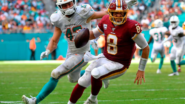 Oct 13, 2019; Miami Gardens, FL, USA; Miami Dolphins linebacker Vince Biegel (47) chases Washington Redskins quarterback Case Keenum (8) during the second half at Hard Rock Stadium. Mandatory Credit: Steve Mitchell-USA TODAY Sports