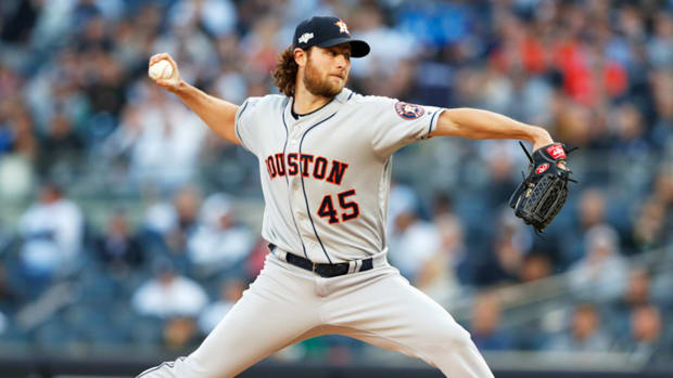 Oct 15, 2019; Bronx, NY, USA; Houston Astros starting pitcher Gerrit Cole (45) throws a pitch during the first inning in game three of the 2019 ALCS playoff baseball series against the New York Yankees at Yankee Stadium. Mandatory Credit: Noah K. Murray-USA TODAY Sports