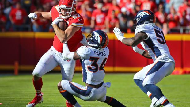 Kansas City Chiefs tight end Travis Kelce (87) runs against Denver Broncos safety Will Parks (34) and linebacker Todd Davis (51) in the second half at Arrowhead Stadium.