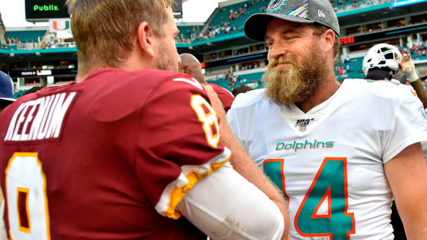 Oct 13, 2019; Miami Gardens, FL, USA; Miami Dolphins quarterback Ryan Fitzpatrick (14) greets Washington Redskins quarterback Case Keenum (8) after their game at Hard Rock Stadium. Mandatory Credit: Steve Mitchell-USA TODAY Sports
