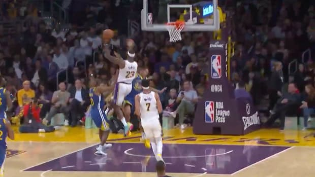Lakers' LeBron James passes to Danny Green
