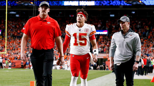 Oct 17, 2019; Denver, CO, USA; Kansas City Chiefs quarterback Patrick Mahomes (15) walks off the field after a play in the second quarter against the Denver Broncos at Empower Field at Mile High. Mandatory Credit: Isaiah J. Downing-USA TODAY Sports