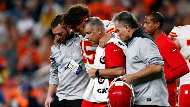 Chiefs' Patrick Mahomes is helped off the field after suffering a knee injury.