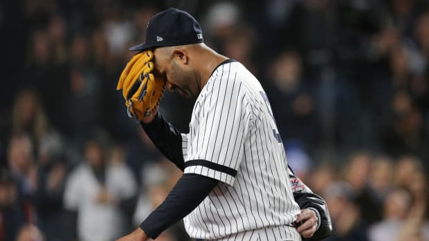 Yankees' CC Sabathia walks off the field after an injury in the ALCS