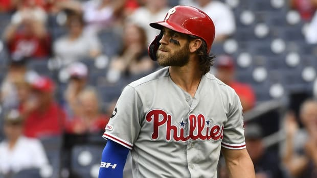 Phillies' Bryce Harper walks off the field at Nationals Park