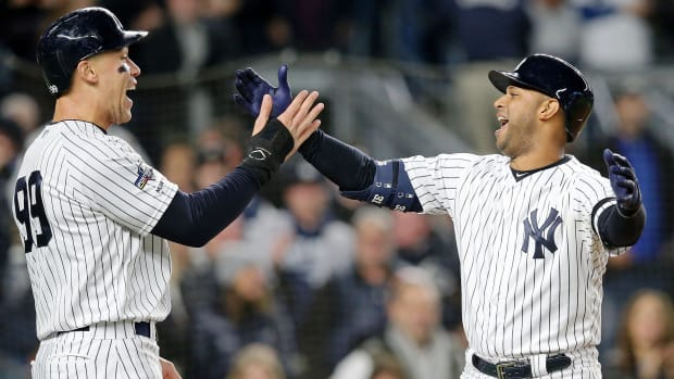 Oct 18, 2019; Bronx, NY, USA; New York Yankees center fielder Aaron Hicks (31) celebrates his three run home run against the Houston Astros with right fielder Aaron Judge (99) during the first inning of game five of the 2019 ALCS playoff baseball series at Yankee Stadium. Mandatory Credit: Brad Penner-USA TODAY Sports