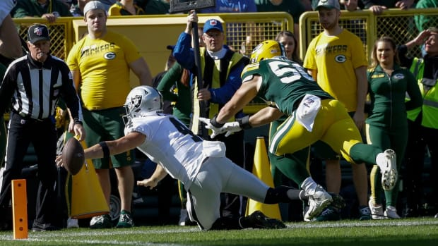 Derek Carr fumbles into the end zone for a touchback against the Green Bay Packers.