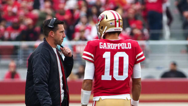 49ers coach Kyle Shanahan talks with quarterback Jimmy Garopollo