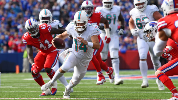 Oct 20, 2019; Orchard Park, NY, USA; Miami Dolphins quarterback Ryan Fitzpatrick (14) runs with the ball against the Buffalo Bills during the third quarter at New Era Field. Mandatory Credit: Rich Barnes-USA TODAY Sports