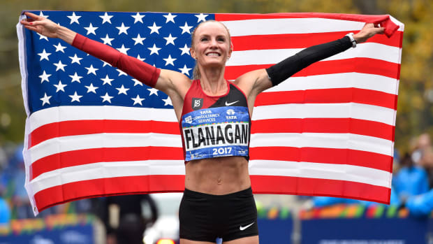 Shalane Flanagan celebrates becoming the first American woman to win the New York City Marathon in 40 years.